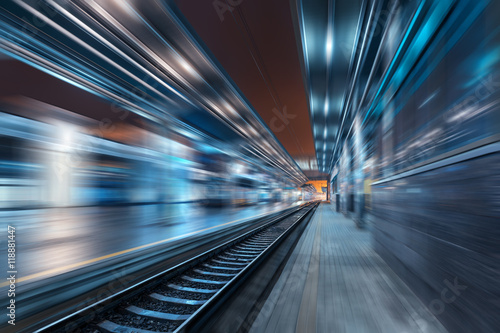 In de dag Centraal Europa Railway station at night with motion blur effect. Railroad