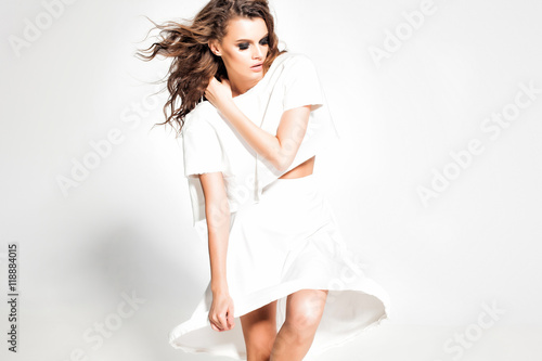 Fotografija  full body of beautiful woman model posing in white dress in the studio