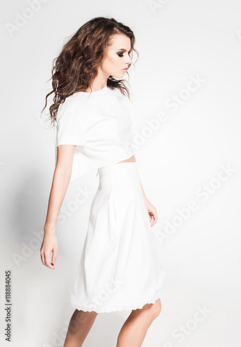 Stampa su Tela  beautiful woman model posing in white dress in the studio