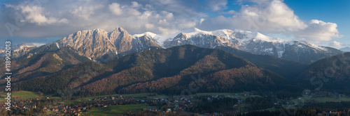 Photo  Panorama of snow-capped High Tatras on the Polish side, with a beautiful cloudy