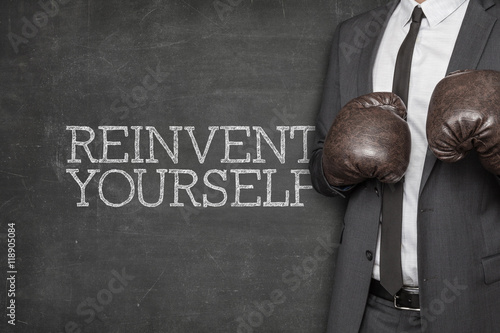 Fotografía  Reinvent yourself on blackboard with businessman on side