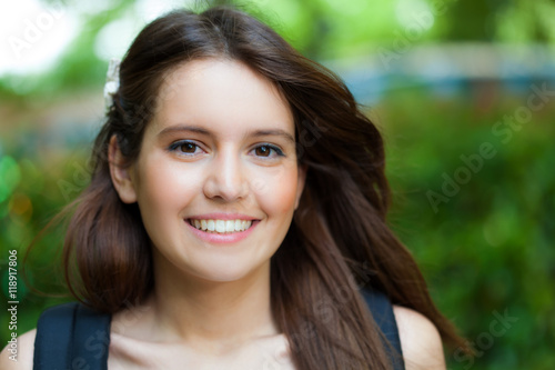 Fototapety, obrazy: Beautiful young woman portrait in a green park