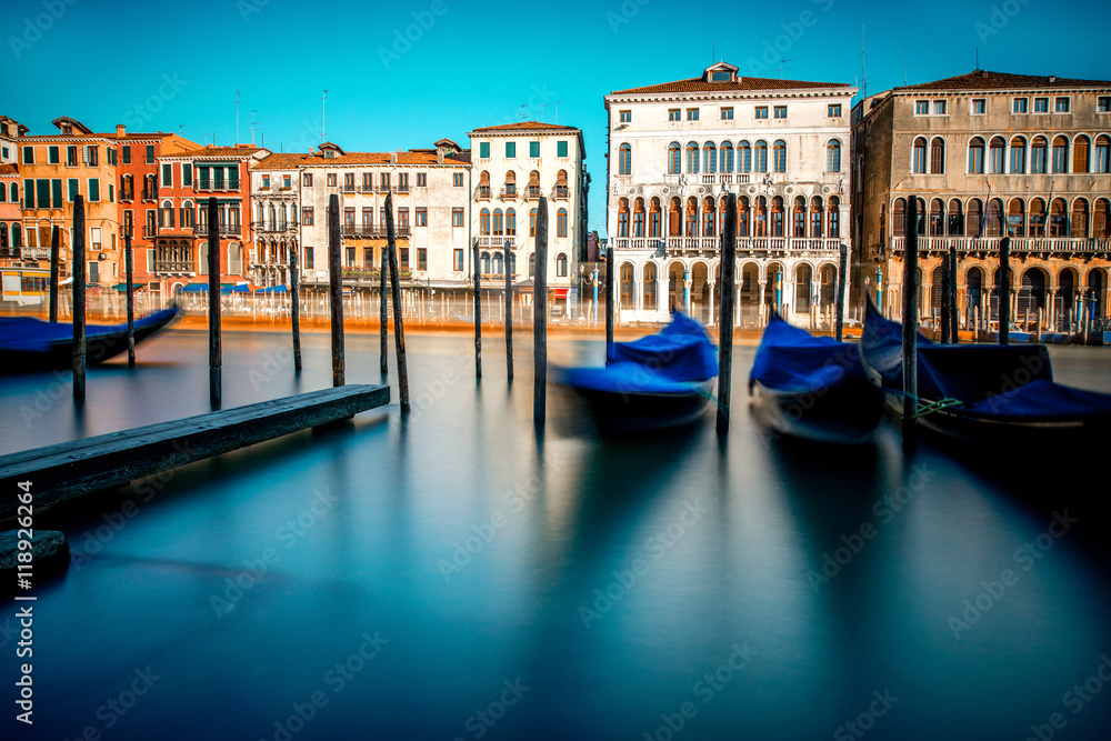 Fototapety, obrazy: Venice cityscape view on Grand canal with colorful buildings and boats at the sunrise. Long exposure image technic with motion blurred boats and glossy water