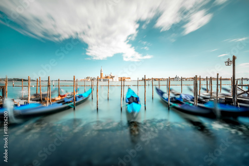 Venice landscape view on San Giorgio Maggiore island with gondolas on the foreground Poster