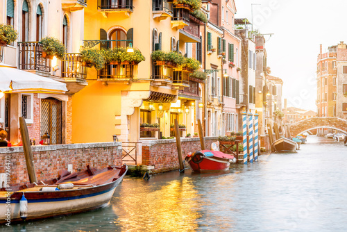 Foto op Canvas Venice Small romantic water canal with restaurants in Dorsoduro region in Venice