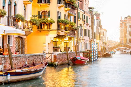 Fotografie, Obraz  Small romantic water canal with restaurants in Dorsoduro region in Venice
