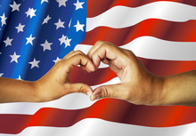 Female Hands Forming A Heart On An American Flag Background. Mother And Child Made A Heart With Their Hands. Unity, Patriotism, Support, Family.