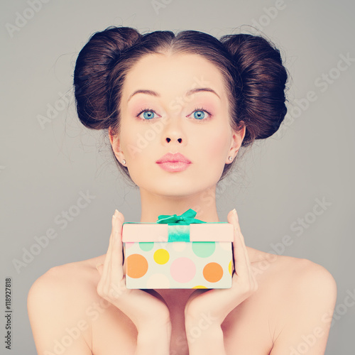 Fotografering  Pretty Woman holding Gift Box