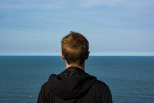 Young Male Looking To Horizon ...