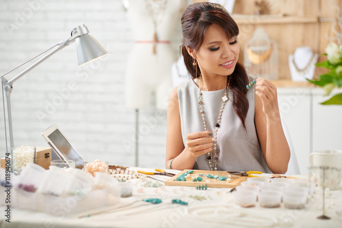 Photo  Female designer making new collection of jewelry
