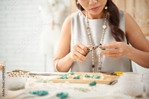 Cropped image of woman concentrated on creation of new jewelry piece Wallpaper Mural