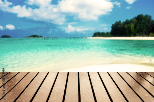 Deurstickers Tropical strand Wood table top on blurred sea beach white sand on andaman sea