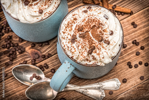 Foto op Plexiglas Chocolade Hot chocolate with whipped cream in mug on a wooden table.