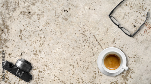Wall Murals Coffee beans Top view of coffee eyeglasses and camera on a granite table.
