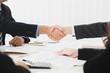 Businessmen making handshake in the meeting