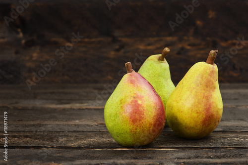 Pears on a rustic wooden kitchen table Wallpaper Mural