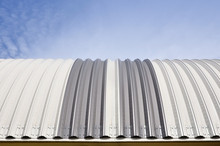 Modern Construction. Metal Ribbed Arch-span Roof Covering. Looking Up, Front View.