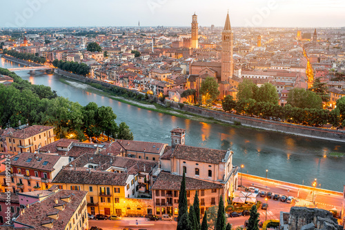 Fotografie, Obraz  Verona panoramic aerial view on illuminated old town on the sunset in Italy