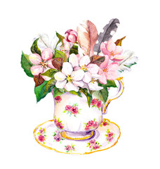 FototapetaPink blossom flowers, vintage feathers in tea cup. Watercolor