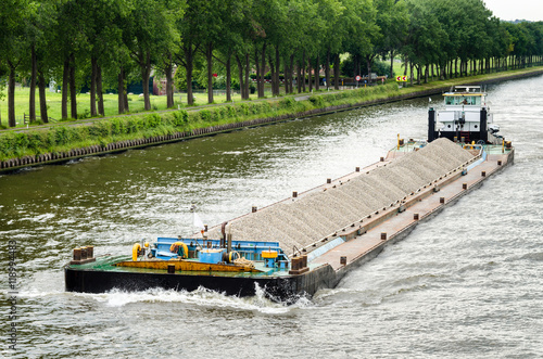 Barge loaded with Gravel on a Canal in The Netherlands Obraz na płótnie