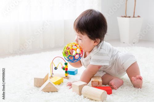 Fotografia  portrait of asian baby playing