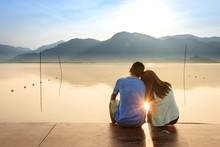 A Couple On The Wooden Port At...