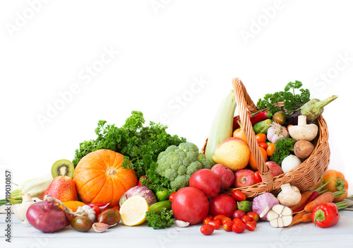 Composition with vegetables and fruits in wicker basket. © BestForYou