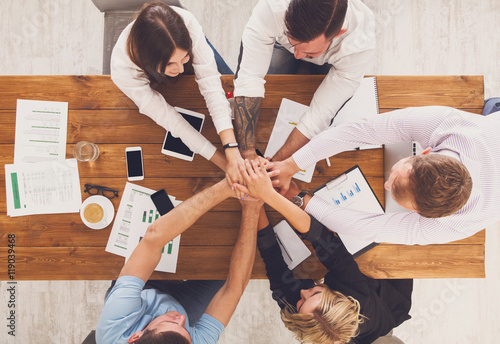 Teamwork and teambuilding concept in office, people connect hands Poster
