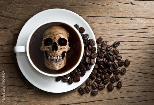 Fotografie, Obraz  Still life photography : human skull soak in white coffee cup in harmful effect