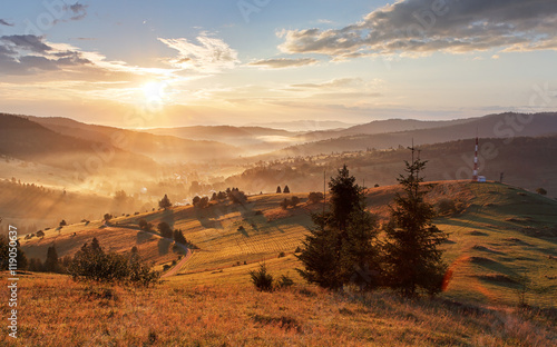Obrazy Polska sun-moutain-forest-fog-landscape-at-sunset-on-meadow