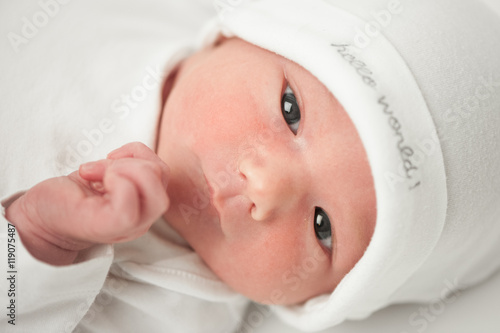 Cadres-photo bureau Fleur face baby in a white hat on a white background