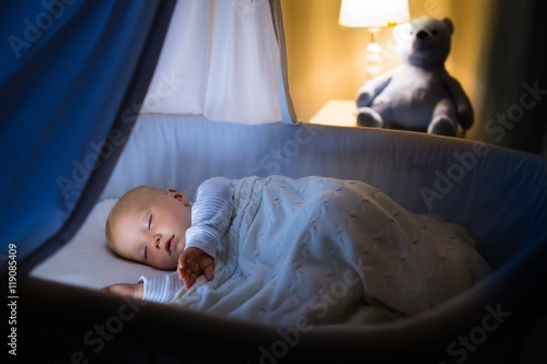 Baby boy sleeping at night Wallpaper Mural