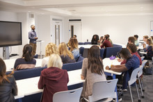 University Students Study In A Classroom With Male Lecturer