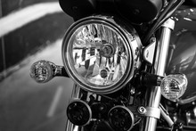Retro Motorcycle With Headlights On Black And White Colors