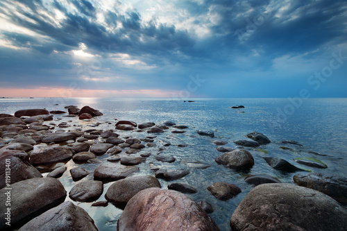 Rocky shores at the sea in sunset light. Lahemaa natural park coastal landscape with beautiful sky