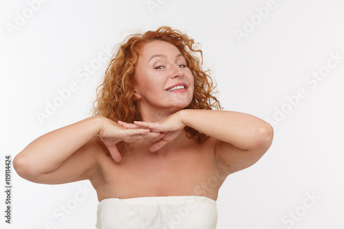 Fotografie, Obraz  Picture of playing mature or middle aged woman expressing positive emotions isolated on white background