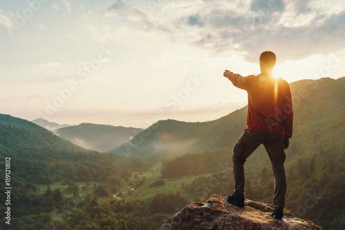 Obraz na płótnie Man looking at sunset