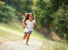 Little Girl Run Through The Park.