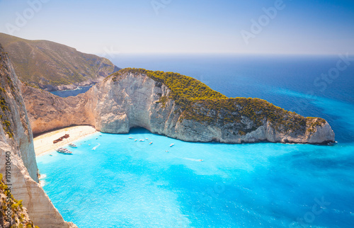 Photo Stands Shipwreck Navagio beach. Island Zakynthos in Ionian Sea
