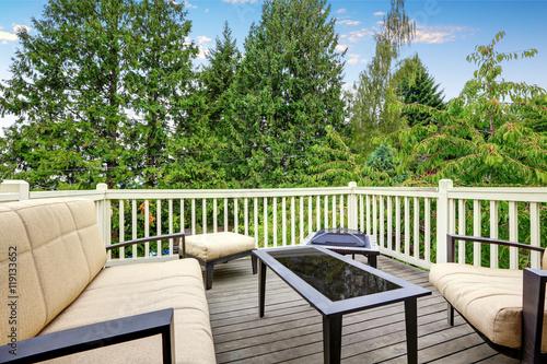 Fototapeta Back deck with outdoor furniture and nice view obraz na płótnie