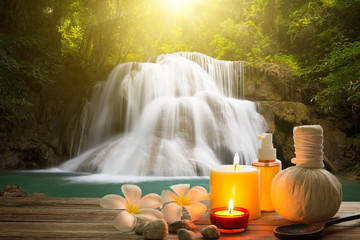 Spa style on wood with copy space and waterfall blur background