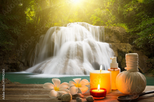 Cascades Spa style on wood with copy space and waterfall blur background