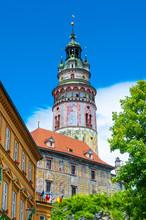 Castle Tower Against Blue Sky In Cesky Krumlov, Czech Republic