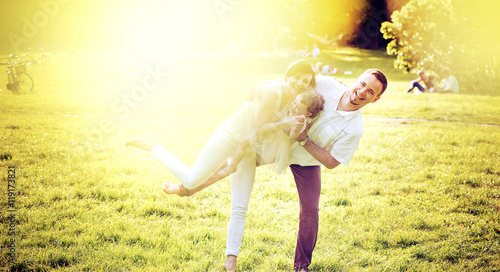 Printed kitchen splashbacks Artist KB Portrait of a delighted family relaxing in the park
