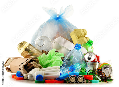 Photo Recyclable garbage consisting of glass, plastic, metal and paper