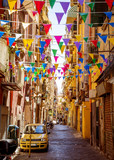 Fototapeta Uliczki - Narrow street in old town of Naples city in Italy
