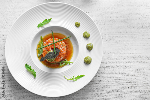 Poster Plat cuisine Delicious red fish with sauce on white plate