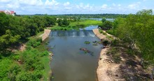 Aerial View , Cold Water Of Small River Flow Over Small Stony Weir