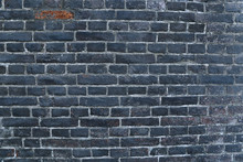 Texture Of A Black Burnt Brick Wall Covered With Soot