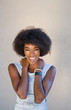 lose up portrait of a beautiful black woman smiling and looking